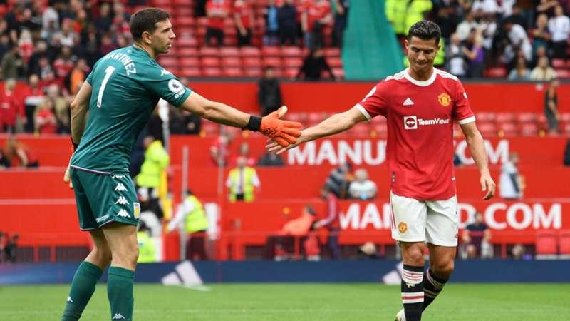 Cristiano Ronaldo y Emiliano Martínez