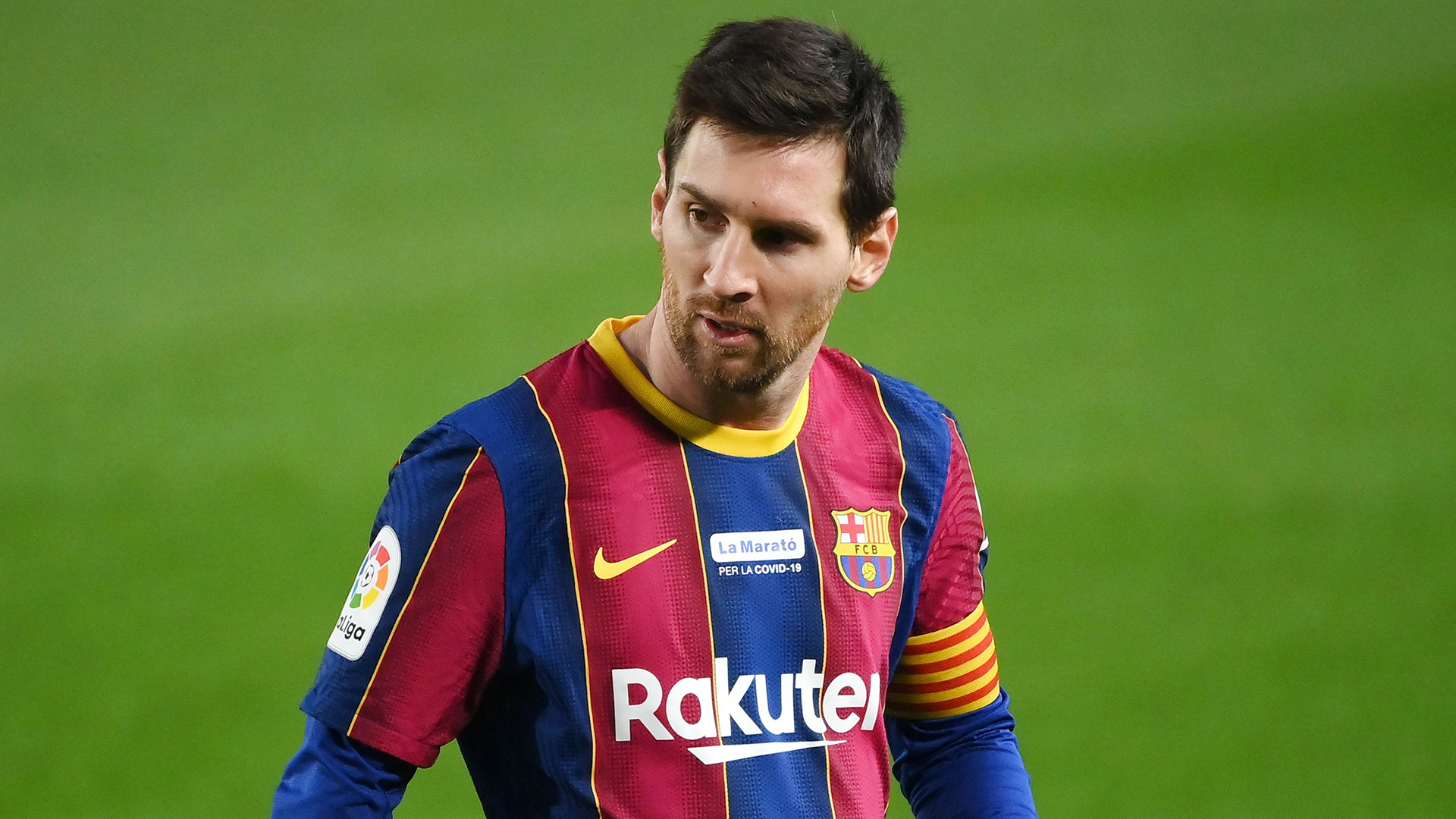 How much does Lionel Messi earn at Barcelona?