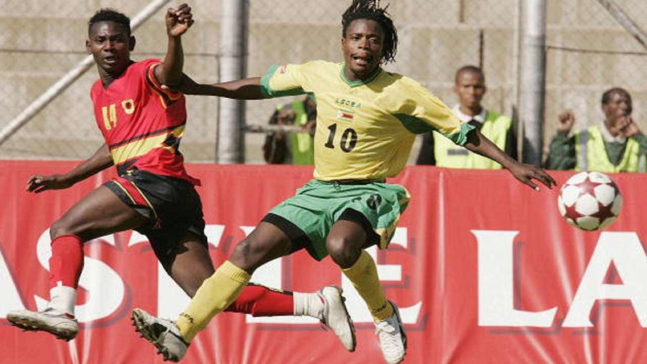 Kalanga of Angola clashes with Gift Lungu of Zimbabwe during the 2005 COSAFA Cup