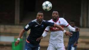 Thabo Moseki of University of Pretoria challenged by Manti Mekoa of Richards Bay FC
