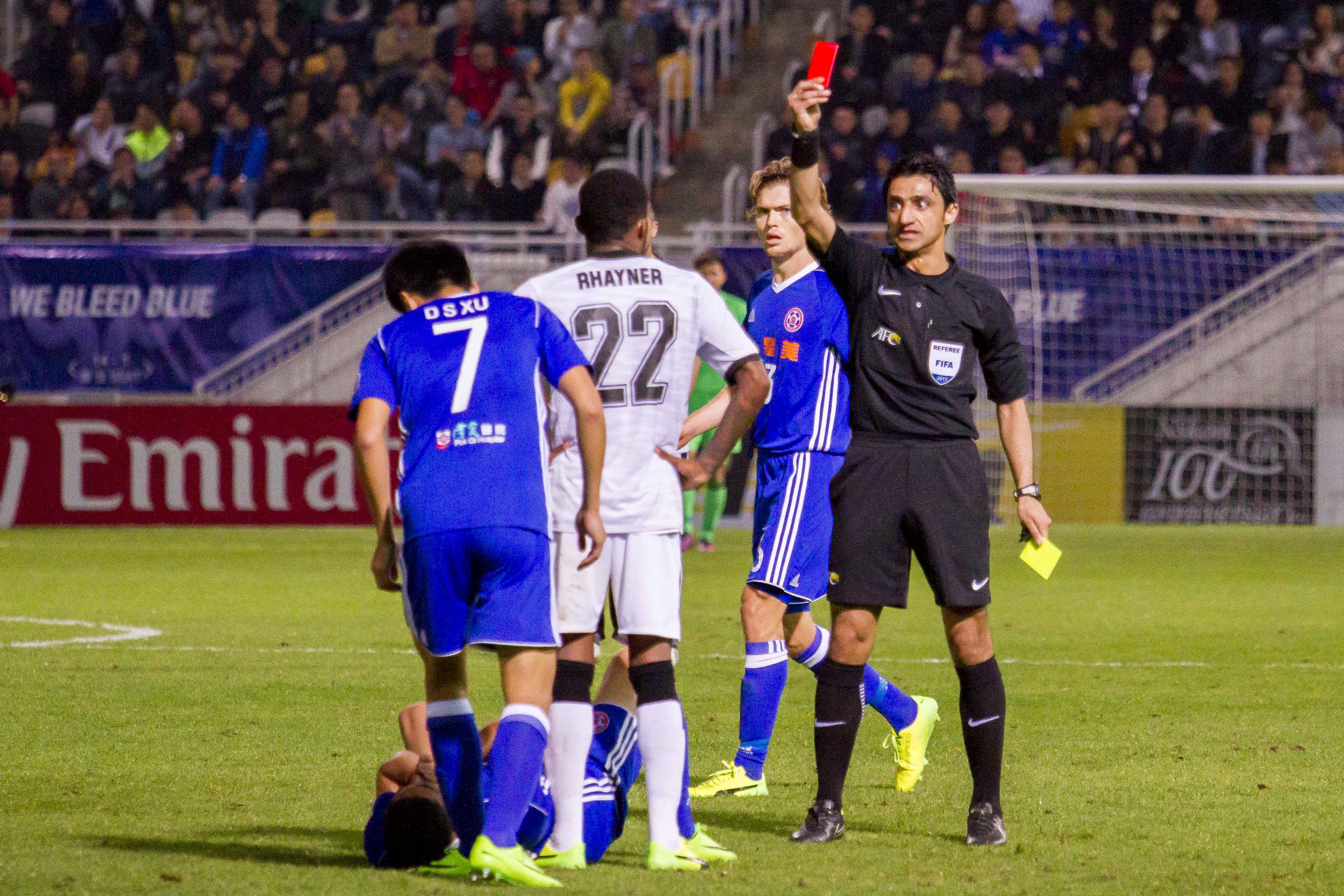 Referee Mohanad Qasim Eesee Sarray shows Rhayner of Kawasaki Frontale (JPN) a red card during the ACL Asian Champions League match between Eastern SC and Kawasaki Frontale at Mongkok Stadium