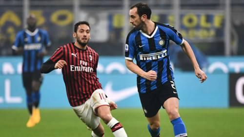 Diego Godin Hakan Calhanoglu Inter Milan