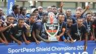Farouk Shikalo and Felly Mulumba of Bandari with FKF Shield Cup.