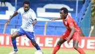 Timonah Wanyonyi (L) of Sofapaka FC contest for the ball with Brian Otieno of Bandari FC.