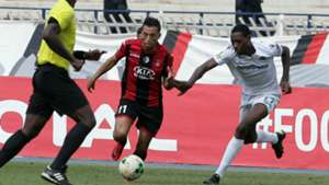 USM Alger player Abderrahmane Meziane (L) and Gor Mahia FC player Charles Momanyi.