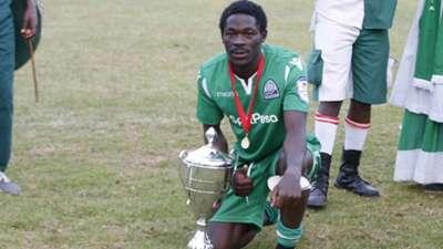 Gor Mahia scorer Lawrence Juma with KPL Super Cup trophy.