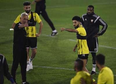 Manager Bert van Marwijk and Al Ain winger Bandar Al Ahbabi