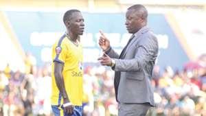 KCCA-coach-Mike-Mutebi-R-gives-instructions-to-Muzamir-Mutyaba