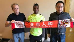Ayub Timbe signs in China.