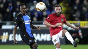 Percy Tau of Brugge (L) in action against Juan Mata of Manchester United (R), February 2020