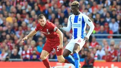 Yves Bissouma of Brighton takes on Liverpool's James Milner