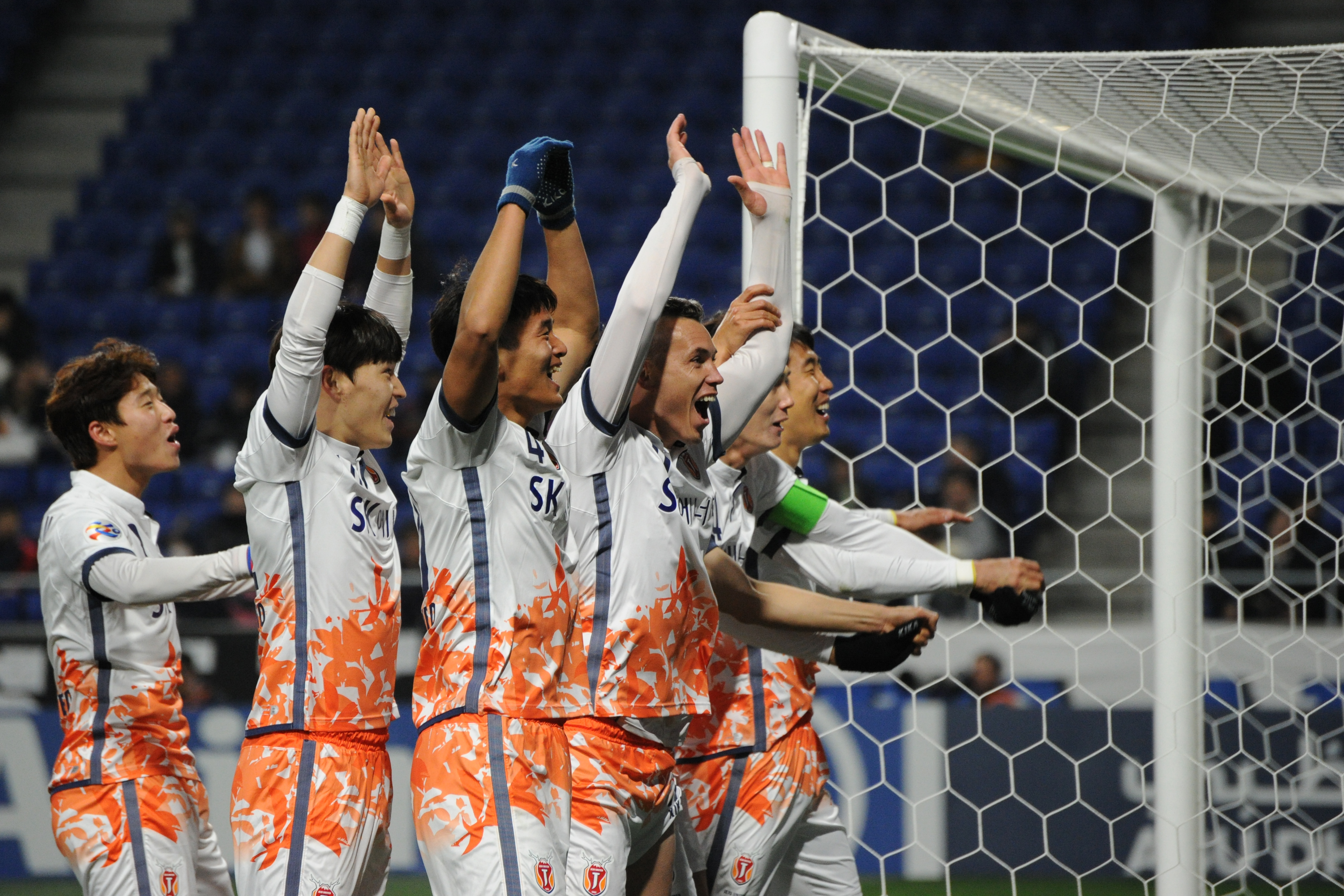 Marcelo Toscano of Jeju United FC and team mates celebrate the third goal during the AFC Champions League Group H match between Gamba Osaka and Jeju United FC