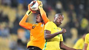 Aishi Manula of Tanzania challenged by Judas Moseamedi of South Africa.