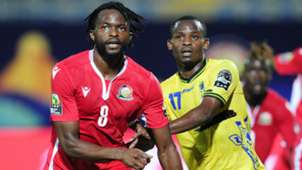 Johanna Omolo of Kenya Harambee Stars is challenged by Farid Mussa of Tanzania.