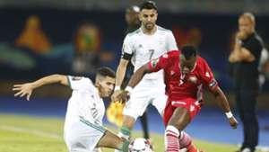 YOUCEF ATAL of Algeria and Riyad Mahrez v AYUB TIMBE of Kenya Harambee Stars.