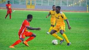 Kotoko defender Augustine Sefa and Ashgold players