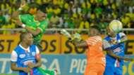 Yanga SC striker Yacouba Songne vs Azam FC Aggrey Morris and Mathias Kigonya.