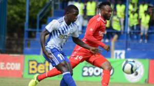 Peter Lwasa (L) of Sofapaka FC tackle Felly Mulumba of Bandari FC.