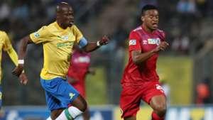 Sipho Mbule of SuperSport United challenged by Hlompho Kekana of Mamelodi Sundowns, September 2019