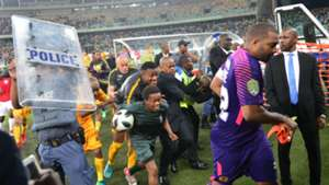 Kaizer Chiefs players run for cover at Moses Mabhida Stadium