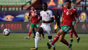 Morocco's defender Romain Saiss (R) passes the ball as he is marked by Namibia's forward Peter Shalulile during the 2019 Africa Cup of Nations