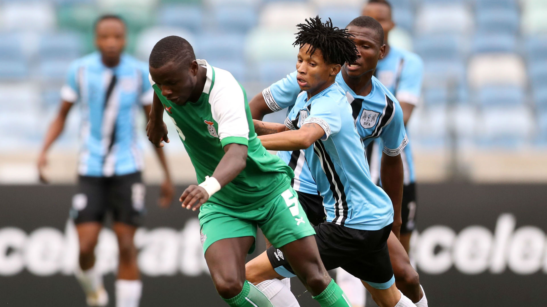Lazarous Kambole of Zambia challenged by Mothusi Cooper of Botswana - June 2019