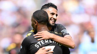 Raheem Sterling of Manchester City celebrates with teammate Riyad Mahrez 2019