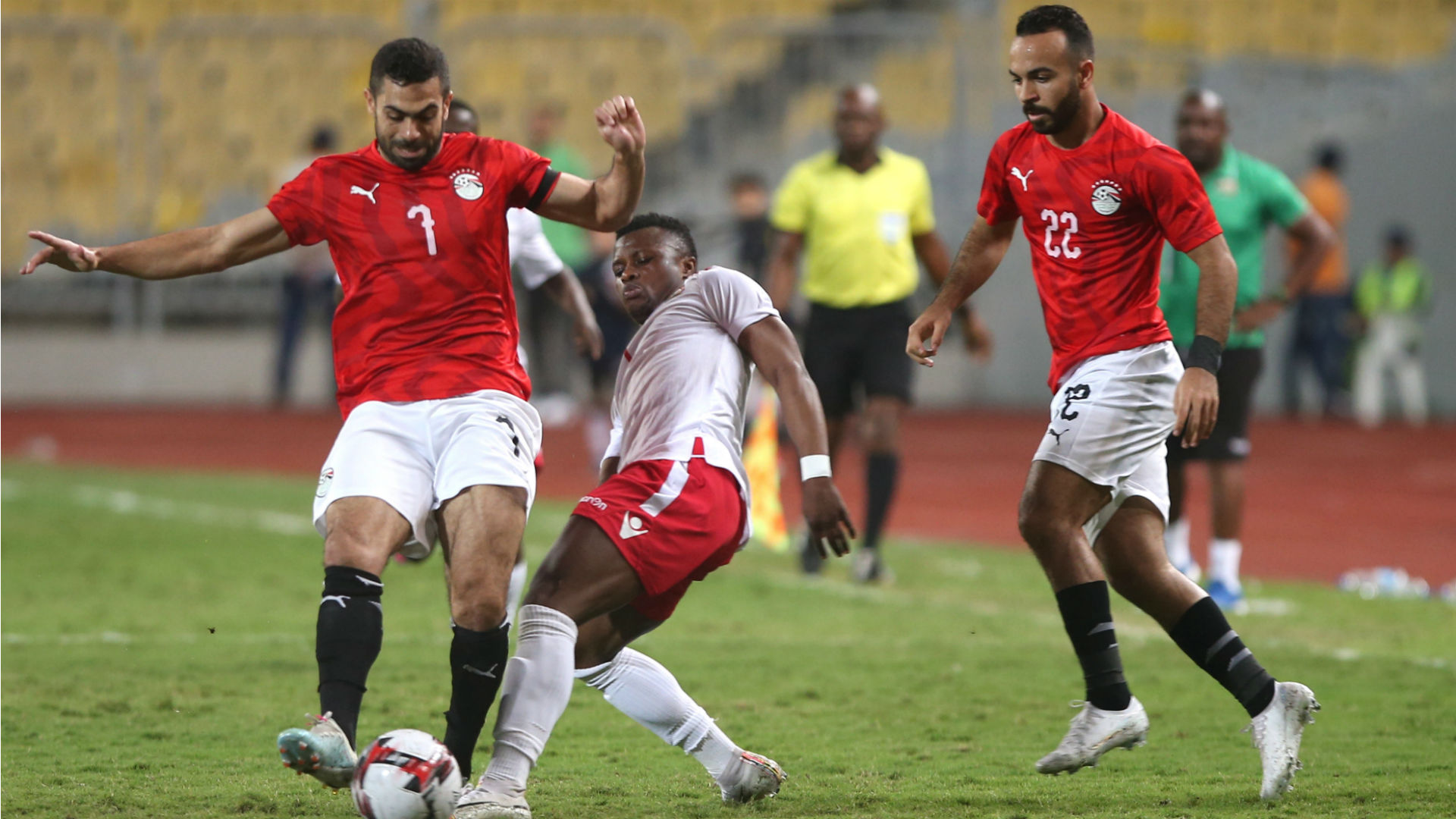 Egypt's Ahmed Fathi (L) in action against Kenya and Harambee Stars player Ayub Timbe.