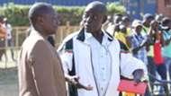 Uganda KCCA coach Mike Mutavi and Sam Timbe of Tusker.