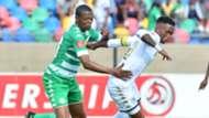 Thabang Monare of Bidvest Wits challenged by Ndumiso Mabena of Bloemfontein Celtic
