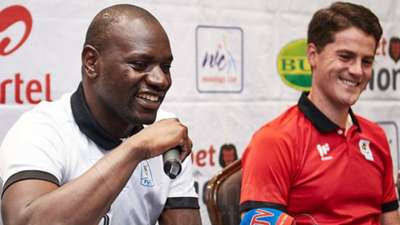 Uganda keeper Denis Onyango and Johnathan McKinstry.