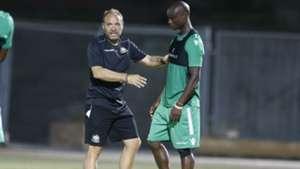Harambee Stars coach Sebastien Migne and Dennis Odhiambo.