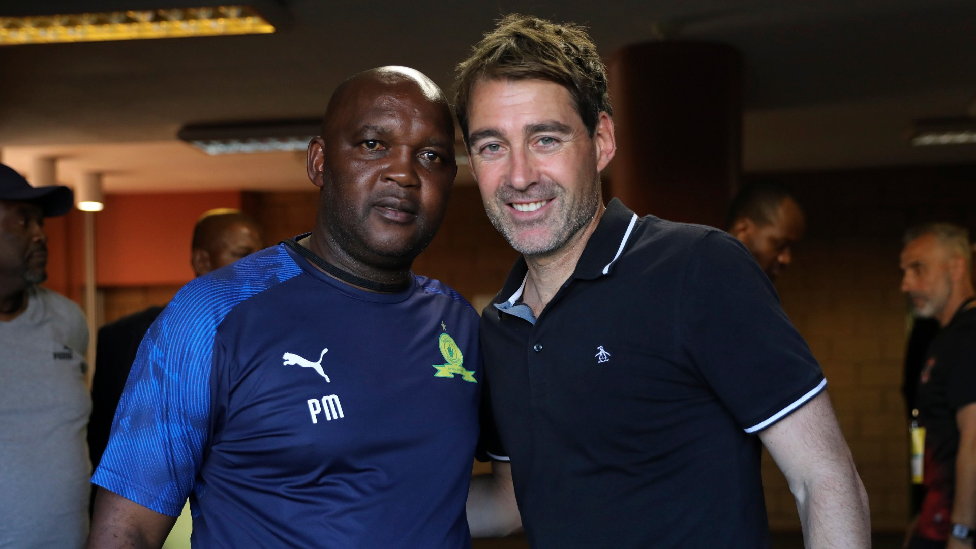 Pitso Mosimane, coach of Sundowns (L) and Rene Weiler, coach of Al Ahly, March 2020