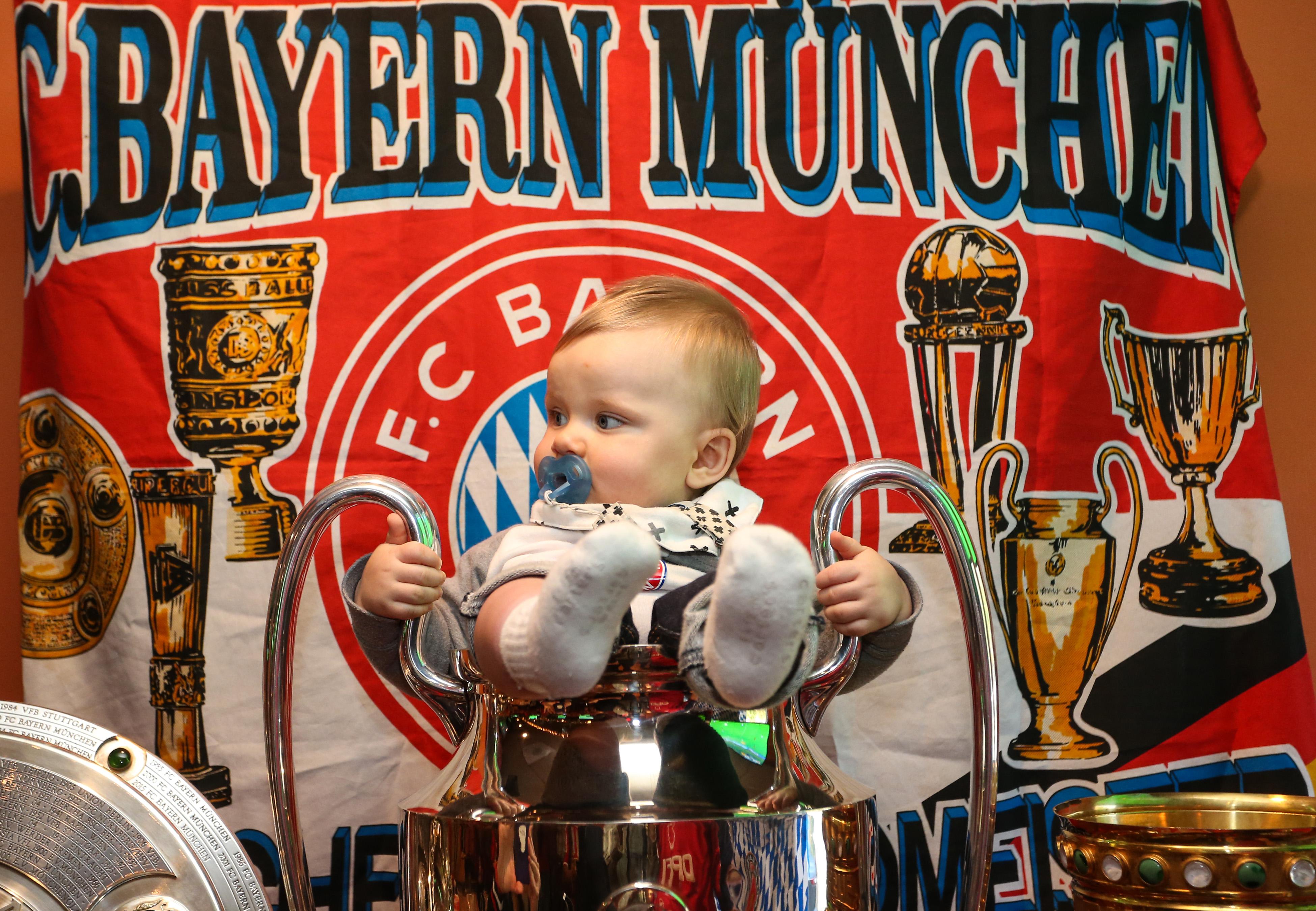 Baby in Bayern Munich trophy