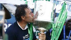 Gor Mahia coach Hassan Oktay with KPL Trophy.