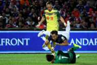 Johor Darul Ta'zim's Aidil Zafuan goes flying under a challenge by his own goalkeeper as Kedah's Ken Ilso Larsen looks on 20/1/2017