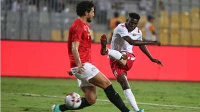 Kenya's Harambee Stars striker Michael Olunga (R) in action against Egypt Player Ahmed Hegazi.