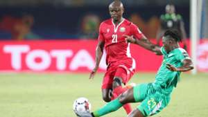 Dennis Omino Odhiambo of Kenya tackled by Lamine Gassama of Senegal.