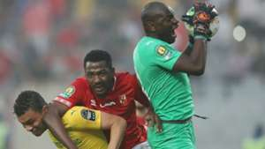 Denis Onyango of Sundowns saves from Oluwafemi Junior Ajayi of Al Ahly, April 2019