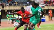 Uganda player vs Malawi.