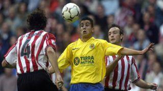 Villarreal's Francisco Nadal Xisco fights for the ball with Athletic de Bilbao's Jesus Maria Lacruz and Aitor Karanka