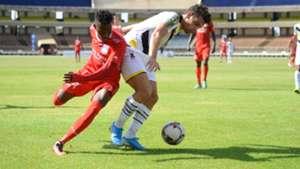 Bandari's FC Hassan Abdalla tussles for the ball against USB Guerdane Ghazi Abderazek.