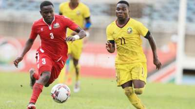 Eric Ouma of Kenya and Harambee Stars vs a Mozambique striker
