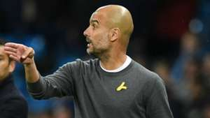 Pep Guardiola Man City yellow ribbon