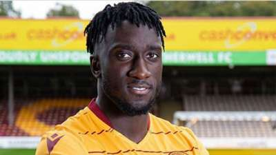 Bevis Mugabi of Uganda signs for Motherwell.
