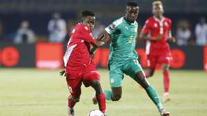 Eric Ouma of Kenya and Harambee Stars tackes Idrissa Gueye of Senegal.