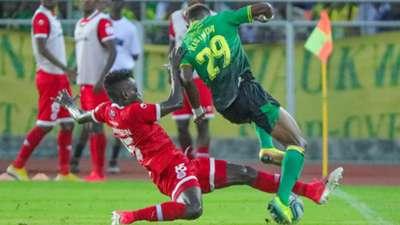 Mohammed Hussein of Simba SC vs Kisinda of Yanga SC.