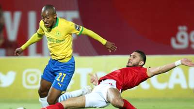 Thapelo Morena of Mamelodi Sundowns challenged by Rami Rabia of Al Ahly