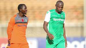 Gor Mahia keeper Fredrick Odhiamboi and Dennis Oliech.