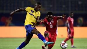 Tanzania's Mbwana Samatta (L) fights for the ball with Kenya's Eric Ouma